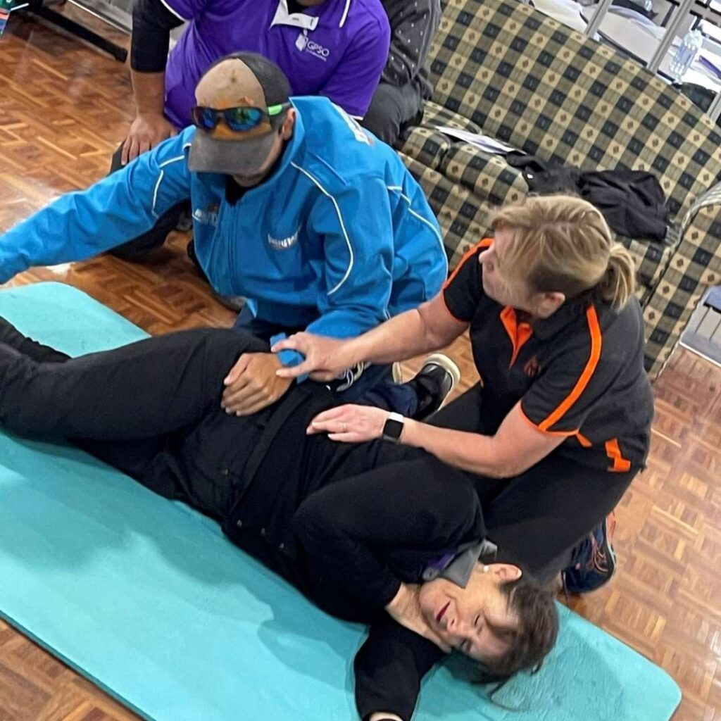 Lilac participants learning CPR skills. -